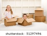 Kids in their new home having fun with cardboard boxes - stock photo
