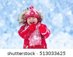 Baby Playing With Snow In...