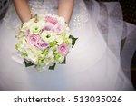 bride holding wedding bouquet | Shutterstock . vector #513035026