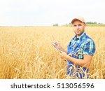farmer in a plaid shirt... | Shutterstock . vector #513056596
