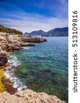 Small photo of Abrupt stony coast and turquoise sea surface. National Park Calanques on the Mediterranean coast