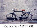 City Bike Over Gray Wall....