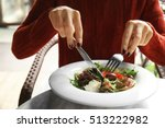 Woman Eating Tasty Salad In Cafe