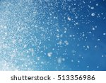 falling snow on the blue sky... | Shutterstock . vector #513356986