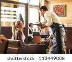 waiter serves group of guests... | Shutterstock . vector #513449008