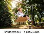 Cute Little Girl On A Swing....