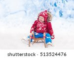 Little Girl Enjoying A Sleigh...