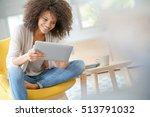 mixed race woman websurfing on... | Shutterstock . vector #513791032