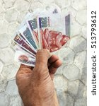 Egyptian Currency In Hand.