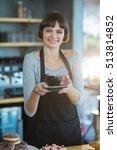 portrait of waitress holding... | Shutterstock . vector #513814852