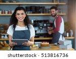 Portrait Of Smiling Waitress...