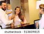 Stock photo picture of family checking in hotel 513839815
