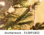 a candy cane hanging in a... | Shutterstock . vector #513891802