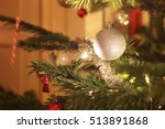 a christmas ornament hanging in ... | Shutterstock . vector #513891868