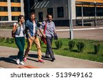 Stock photo three students walking on campus 513949162