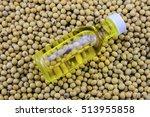 bottle of oil on soy bean... | Shutterstock . vector #513955858