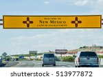 Small photo of El Paso, USA - July 26, 2015: Welcome to New Mexico sign with land of enchantment words on highway at Texas border