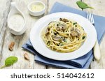 creamy mushroom spinach pasta.... | Shutterstock . vector #514042612