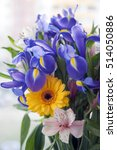 Small photo of irises, chrysanthemum and alstroemeria in a bouquet