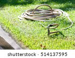 hydrant and rubber tube on the... | Shutterstock . vector #514137595