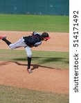 Small photo of Youth little league baseball pitcher after windup on the mound during a game.