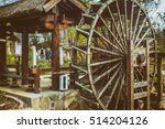 Water Wheels On River Amidst...