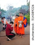 Small photo of Mae Hong Son, THAILAND - October 25, 2014 : Man gives respect to monks after giving alms in the morning.