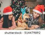 two girls with santa hat and... | Shutterstock . vector #514479892