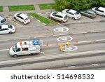 Small photo of MOSCOW, RUSSIA - September 24.2016: Brigade of platelayers inflict the signs of limitation of speed of cars on the asphalt of road