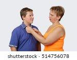 woman fastens teenage boy shirt ... | Shutterstock . vector #514756078