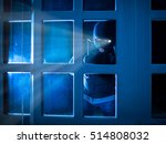 burglar standing in the dark... | Shutterstock . vector #514808032
