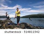 Young People Are Fishing On Th...