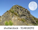 Small photo of The Lorelei rock and big moon (German Loreley 132 m) is a 433 ft high steep slate rock on the right bank of the River Rhine in the Rhine Gorge at Sankt Goarshausen in Germany.