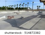 Concrete Skate Park With Grind...