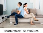 sad young couple sitting back... | Shutterstock . vector #514909825