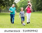 happy family playing soccer... | Shutterstock . vector #514909942