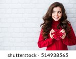 smiling woman hold red gift box.... | Shutterstock . vector #514938565