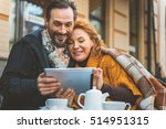loving couple using gadget in... | Shutterstock . vector #514951315