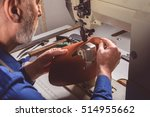 craftsman stitching a leather... | Shutterstock . vector #514955662