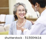 Family Doctor Checking Smiling...