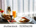 Stock photo delicious breakfast with pastries eggs fruits and juice served in hotel room in room dining 515056198