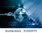 hi-tech earth globe against fiber optic background - stock photo