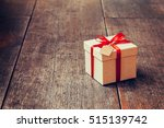 brown gift box and red ribbon... | Shutterstock . vector #515139742