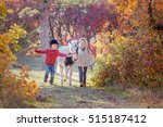 Girl And Boy Walking At Autumn...