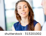 young businesswoman sitting at... | Shutterstock . vector #515201002