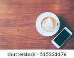 top view of a cup of hot coffee ... | Shutterstock . vector #515321176