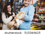 Stock photo young man and woman taking their persian cat to the pet shop they buying some pet accessories and 515364625