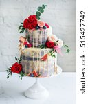wedding cake with flowers  figs ... | Shutterstock . vector #515427742