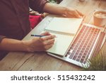 man write on notebook with... | Shutterstock . vector #515432242