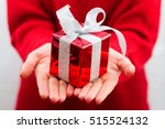 girl giving decorated gift with ... | Shutterstock . vector #515524132